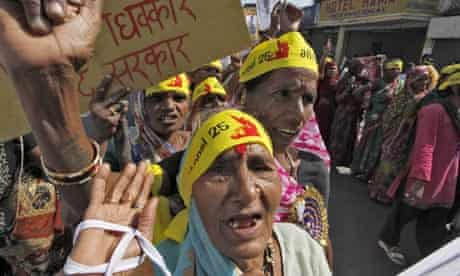 Activists protest on the 25th anniversary of the Bhopal gas disaster