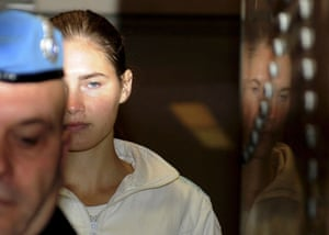 Meredith Kercher trial: 28 November 2009: Amanda Knox is escorted into the courtroom
