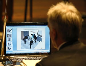 Meredith Kercher trial: Amanda Knox's lawyer Carlo Dalla Vedova watches a computer rendering