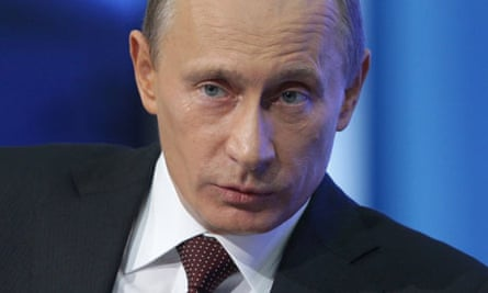 Vladimir Putin gestures while answering a question during his annual televised phone-in show Moscow