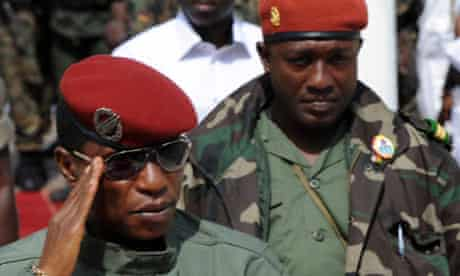 Guinea president Moussa Dadis Camara, followed by his aide Toumba Diakite.