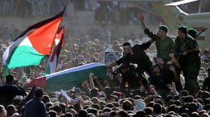 Pictures of the Decade: 12 November 2004:  Security men with Yasser Arafat's coffin