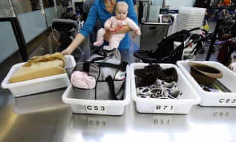 A passenger and baby at a security checkpoint at Los Angeles International Airport.
