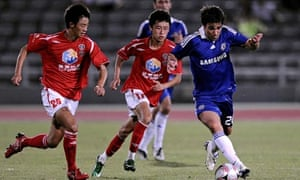 Chelsea's Deco is chased by Chengdu Blades' Xia Qiqi and Zhang Yuan