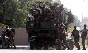 Pakistani soldiers secure the scene after an attack on a Rawalpindi mosque near army headquarters