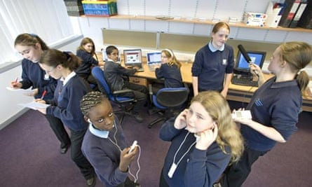 Secondary school children work on a podcasting project