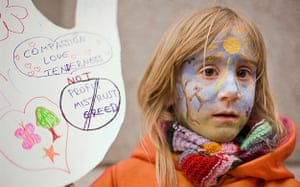 Wave climate change demo: Six year old Daci holds a placard at The Wave demonstration