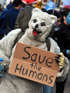 Wave climate change demo: A campaigner dressed as a polar bear joins the march