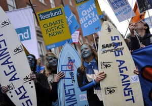 Wave climate change demo: Holding surf boards, climate change demonstrators protest in London