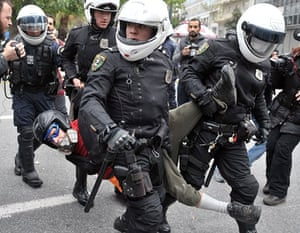 Athens demonstrations: Police carries a detained demonstrator in central Athens