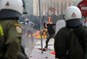 Athens demonstrations: Youths clash with police in Athens during a massive demonstration