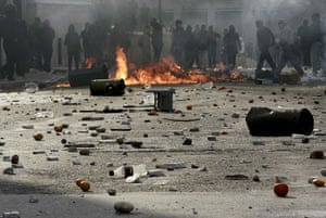 Athens demonstrations: Protesters throw stones at policemen during a march in Athens
