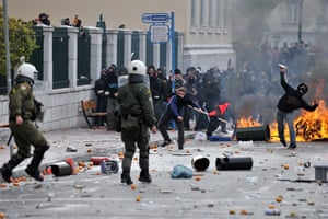 Athens demonstrations: Demonstrators clash with riot police during a protest in Athens