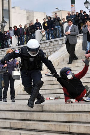 Athens demonstrations: Police detain a demonstrator in central Athens
