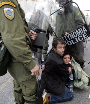 Athens demonstrations: Protesters are detained by policemen during a march