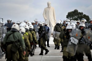 Violence in Athens: Greek riot police stand around of a statue Eleftherios Venizelos