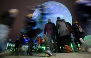 Copenhagen diary: People walk by the gigantic earth globe on the town square, COP15