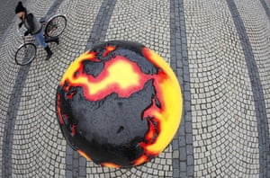 Copenhagen diary: A woman with a bicycle walks an installation in downtown COP15