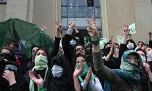 Iranian opposition supporters demonstrate at Tehran University in Iran.