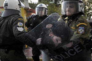 more voilence in athens : Riot police detain a youth during clashes in central Athens