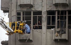 Baghdad bomb attacks: Firefighters evacuate the body of a victim killed in a bomb attack