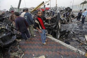 Baghdad bomb attacks: Iraqis at the site of a bomb attack near the Labour Ministry building