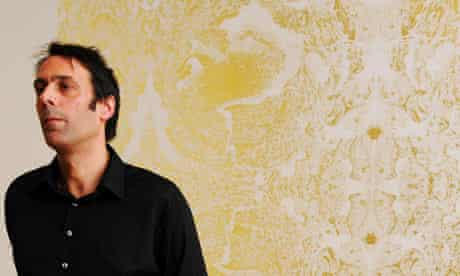 Winner of the Turner Prize 2009 Richard Wright in front of his art