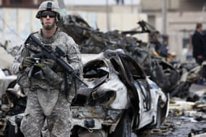 Baghdad bomb attacks: A US soldier secures the site of a bomb blast on Cairo Street in Baghdad