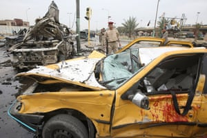 Baghdad bomb attacks: US soldiers secure the site of a bomb blast on Cairo Street in Baghdad