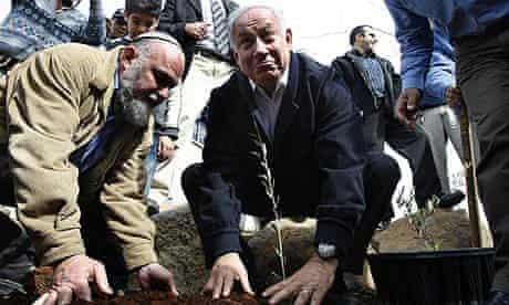 Israel's Likud Party leader Netanyahu plants a sapling in Keshet