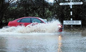 A car drives through floodwater in Essex
