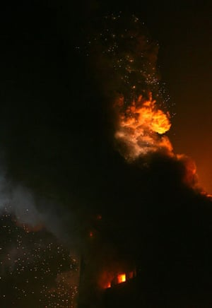 Beijing fire: Smoke pours out on the unfinished Mandarin Oriental Hotel