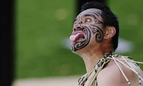 A Maori performs a Haka
