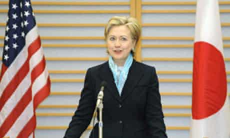 U.S. Secretary of State Hillary Clinton delivers a speech upon her arrival at Tokyo's Haneda Airport
