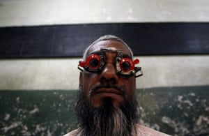 24 hours in pictures: A man gets his eye tested at a free eye-care camp in Mumbai