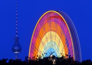 Big wheels : A giant wheel turns in Berlin, Germany.
