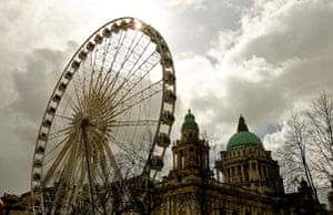 Big wheels : Belfast's Ferris Wheel towers over City Hall in Donegall Square.
