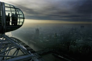 Big wheels : Passengers on the London Eye watch the London skyline.
