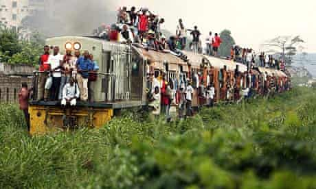 Passengers on a commuter trail in Kinshasa, Democratic Republic of Congo