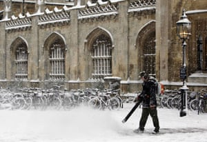 Gallery Snow in England: Cambridge: A man clears snow outside Kings College.