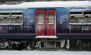 Gallery Snow in England: East Croydon: A snow covered train at the railway station in south London.