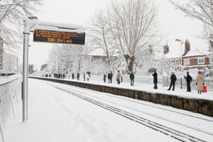 Gallery Snow in England: Mortlake: A sign advises passengers at Mortlake train station.
