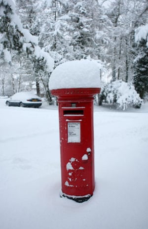 Gallery Snow in England: Carshalton: A pillar box stands covered in snow.