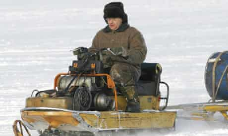 Russian on snowmobile