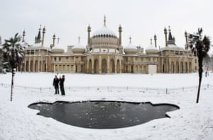 Gallery Snow in England: Brighton:  A couple take photographs in front of the Brighton Pavilion.