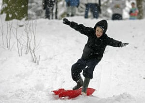Gallery Snow in England: Croydon: Jimmy Marsh sledges in a park in south London.