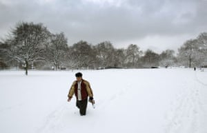 Gallery Snow in England: London: A man trudges his way through the snow in St James's Park.