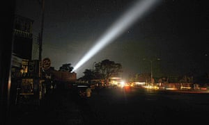 Search lights sweep the sky over Colombo during an air raid by the Tamil Tigers