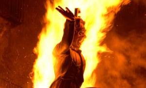 A mannequin burns burns during Las Fallas fiesta, Valencia