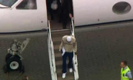 Binyam Mohamed, centre in white, arrives at RAF Northolt after being held at Guantanamo Bay.